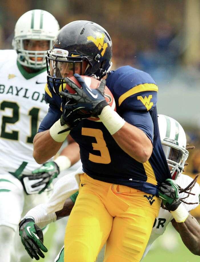 West Virginia's Stedman Bailey beats Baylor's beleaguered K.J. Morton for a 47-yard touchdown catch. Photo: Christopher Jackson / FRE170573 AP