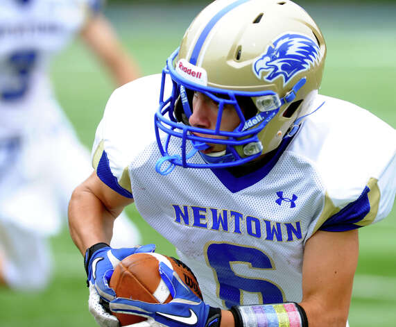 Newtown's #6 Jack Lago intercepted this Stratford pass taking it all the way to the endzone for a touchdown, during football action in Stratford, Conn. on Saturday September 29, 2012. Photo: Christian Abraham / Connecticut Post