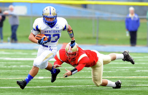 Newtown's #33 Nicholas Rubino shakes Stratford's #55 Daniel DellaVecchia, during football action in Stratford, Conn. on Saturday September 29, 2012. Photo: Christian Abraham / Connecticut Post
