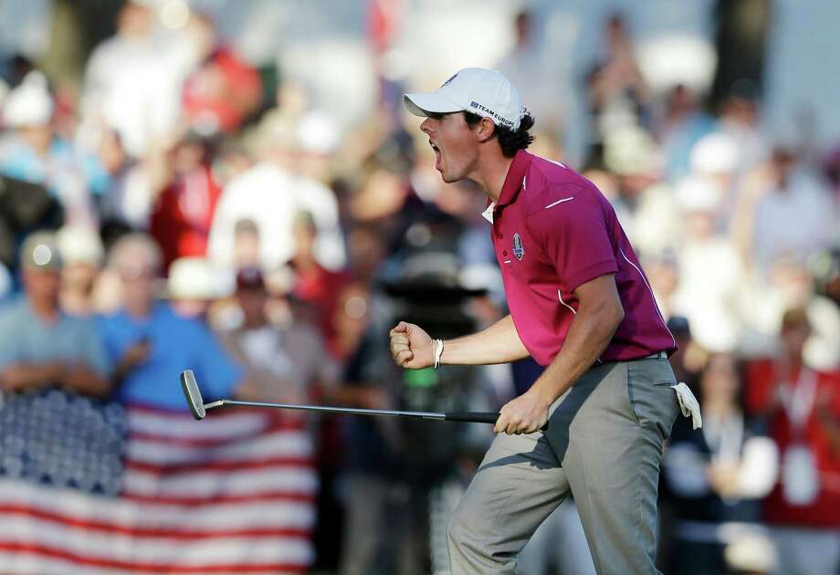 Europe's Rory McIlroy reacts after making a birdie putt on the 13th hole during a four-ball match at the Ryder Cup PGA golf tournament Saturday, Sept. 29, 2012, at the Medinah Country Club in Medinah, Ill. (AP Photo/Chris Carlson) Photo: Chris Carlson