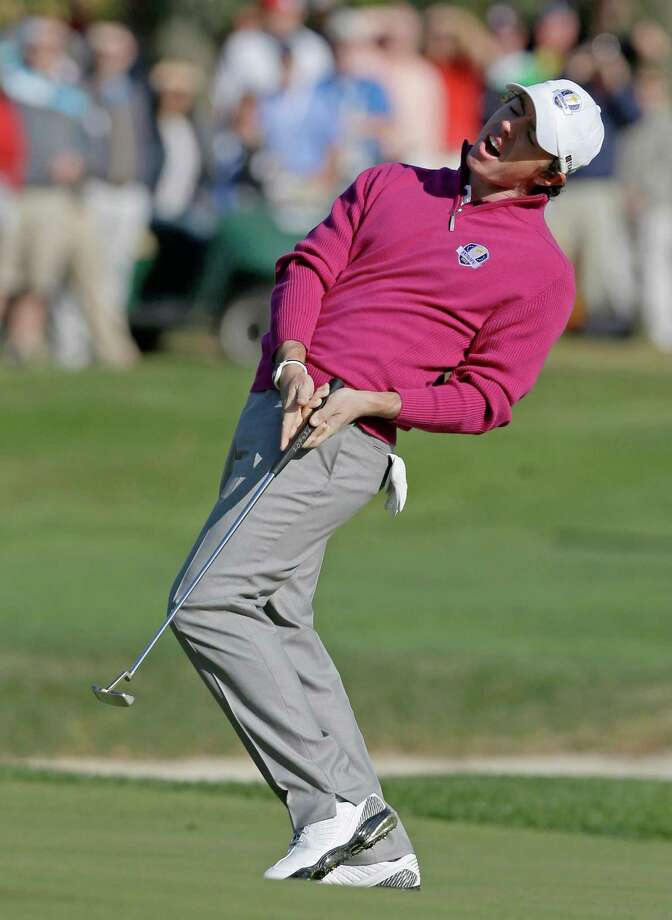 Europe's Rory McIlroy reacts after missing a birdie putt on the fifth hole during a foursomes match at the Ryder Cup PGA golf tournament Saturday, Sept. 29, 2012, at the Medinah Country Club in Medinah, Ill. (AP Photo/Chris Carlson) Photo: Chris Carlson