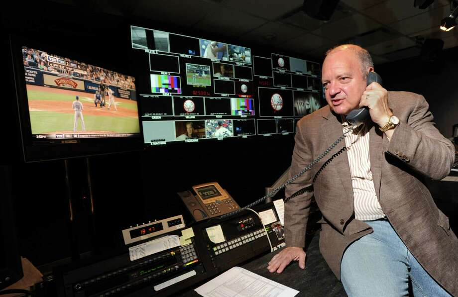 Greenwich resident John Filipelli, program director at YES Network, speaks on the phone while in the television control room of the network in Stamford,Tuesday, Aug. 14, 2012. Photo: Bob Luckey / Greenwich Time