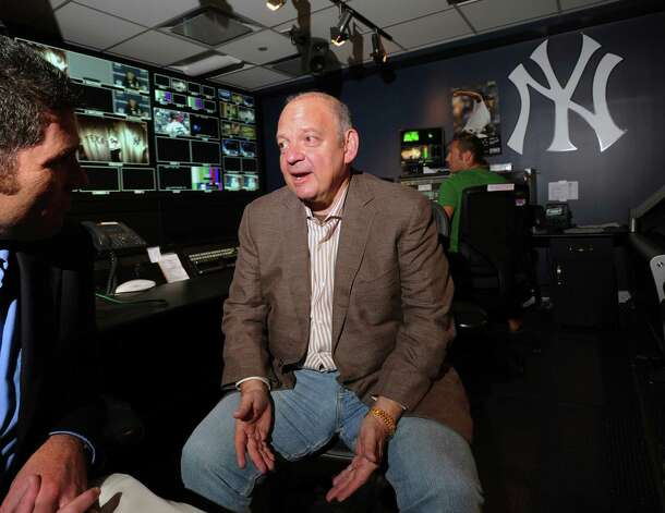 Greenwich resident John Filipelli, center, program director at YES Network, in the television control room of the network in Stamford,Tuesday, Aug. 14, 2012. Photo: Bob Luckey / Greenwich Time