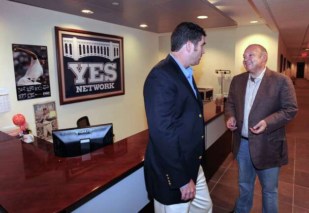 Greenwich resident John Filipelli, right, program director at YES Network, speaks with Ed Delaney, senior vice president of broadcast operations & engineering for YES at the network's office in Stamford,Tuesday, Aug. 14, 2012. Photo: Bob Luckey / Greenwich Time