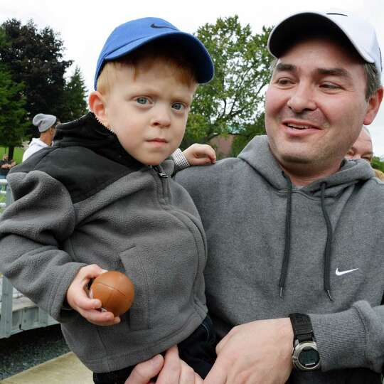 Watervliet fans John Vana of Clifton Park and his two-year-old son Dylan during Saturday's home game