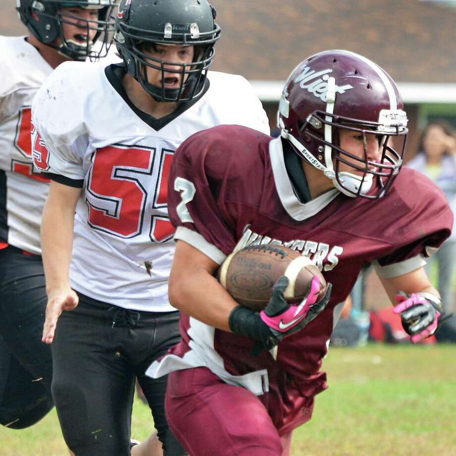 Watervliet's #2 Nick Bowen out runs a couple of Chatham defenders during Saturday's home game against Chatham Sept. 29, 2012.  (John Carl D'Annibale / Times Union) Photo: John Carl D'Annibale / 00019408A
