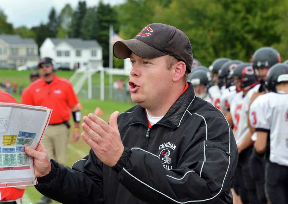 Chatham head coach Shaen Caldwell sends a play in from the sidelines during Saturday's game at Watervliet High Sept. 29, 2012.  (John Carl D'Annibale / Times Union) Photo: John Carl D'Annibale / 00019408A