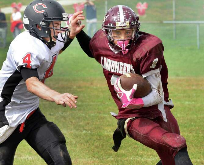 Chatham's #4 Tyler VanBrunt, left, closes in on Watervliet's #1 Jordan Gleason during Saturday's gam