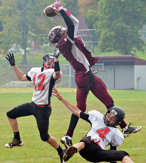 Watervliet's #1 Jordan Gleason has a pass play broken up by Chatham's #12 Jon Mackerer, left, and #4
