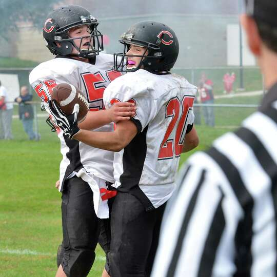 Chatham's #56 Danny Kneller, left, and #20 R.J. Sardo celebrate Sardo's TD against Watervliet High S