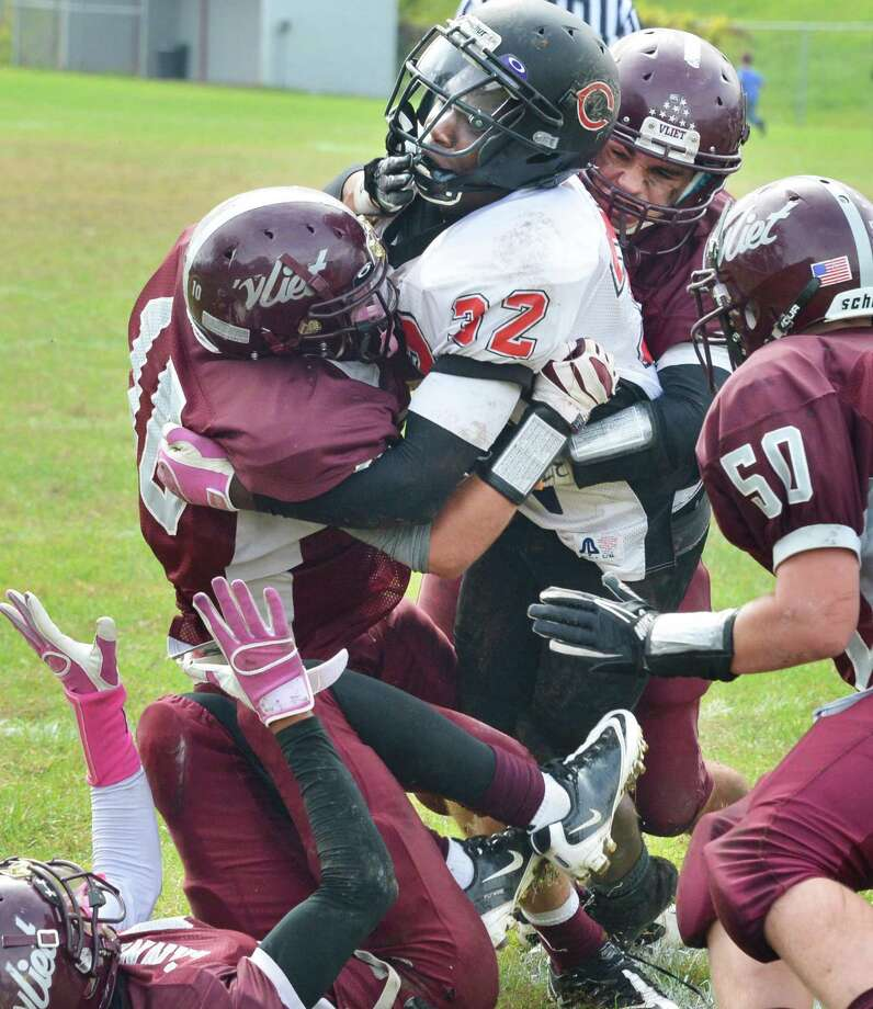 Chatham's #32 Al Kelly, center, wrestles his way to a touchdown against Watervliet High Saturday Sept. 29, 2012.  (John Carl D'Annibale / Times Union) Photo: John Carl D'Annibale / 00019408A