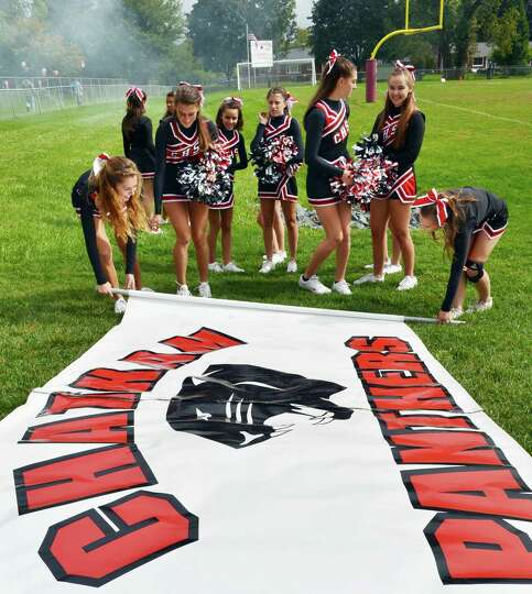 Chatham cheerleaders ready a banner before their game against Watervliet High Sept. 29, 2012.  (John
