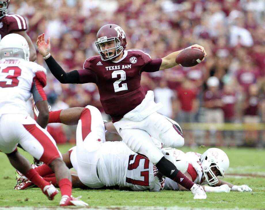 Johnny Manziel terrorized the Arkansas defense, throwing for 453 yards and rushing for 104 more. Photo: Karen Warren / © 2012  Houston Chronicle
