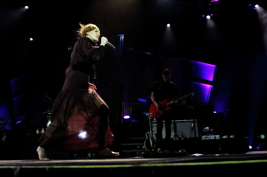 Lead singer Florence Welch of Florence + the Machine performing at The Woodlands Pavilion, 2005 Lake Robbins Drive, Saturday, Sept. 29, 2012, in The Woodlands. Photo: Melissa Phillip, Houston Chronicle / © 2012 Houston Chronicle