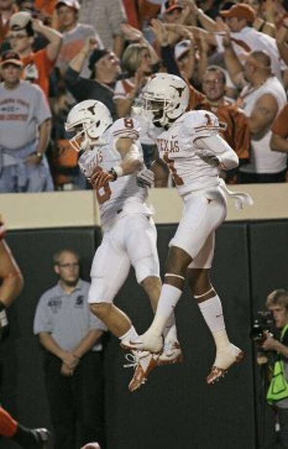 Wide receivers Mike Davis (1) and Jaxon Shipley (8) of Texas celebrate a touchdown against Oklahoma State on Sept. 29, 2012 at Boone Pickens Stadium in Stillwater, Oklahoma. (Brett Deering / Getty Images)