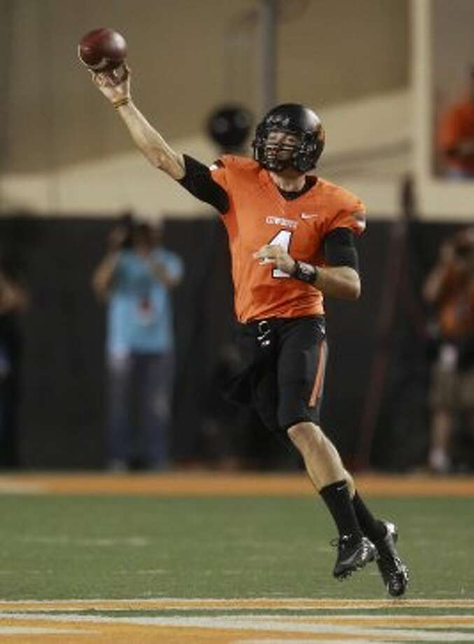 Oklahoma State quarterback J.W. Walsh passes against Texas in the first quarter in Stillwater, Okla., Saturday, Sept. 29, 2012. (Sue Ogrocki / Associated Press)