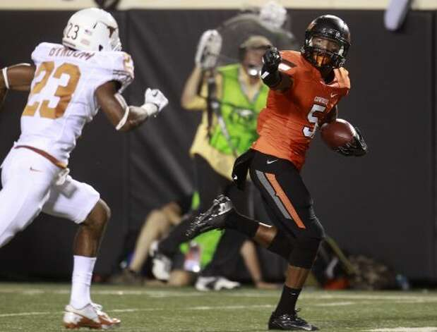 Oklahoma State wide receiver Josh Stewart (5) runs past Texas cornerback Carrington Byndom (23) for a touchdown in the first quarter in Stillwater, Okla., Saturday, Sept. 29, 2012. (Sue Ogrocki / Associated Press)