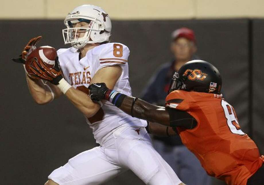 Texas wide receiver Jaxon Shipley (8) catches a touchdown pass in front of Oklahoma State safety Daytawion Lowe (8) during the first quarter in Stillwater, Okla., Saturday, Sept. 29, 2012. (Sue Ogrocki / Associated Press)