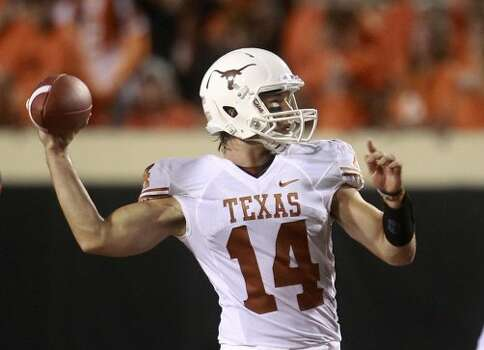 Texas quarterback David Ash passes against Oklahoma State in the second quarter in Stillwater, Okla., Saturday, Sept. 29, 2012.  (Sue Ogrocki / Associated Press)