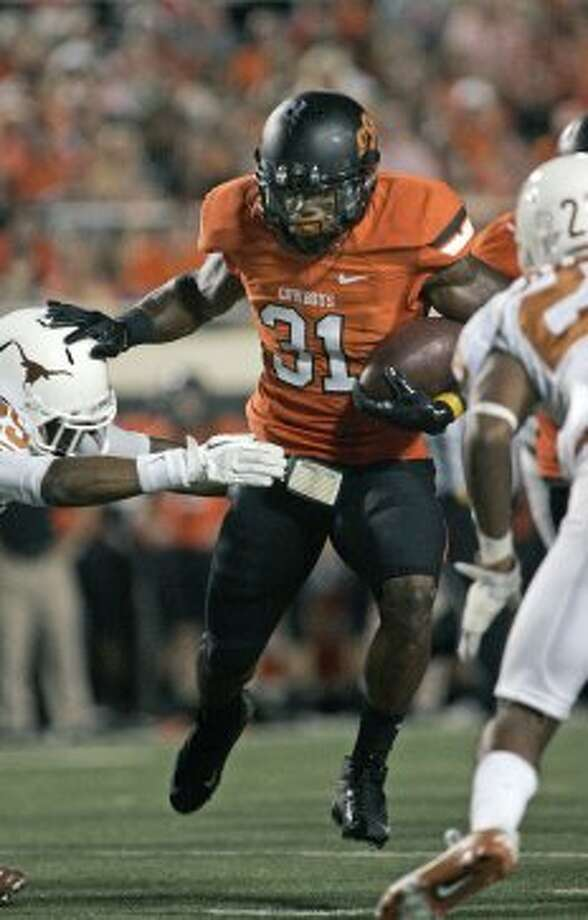 Running back Jeremy Smith (31) of Oklahoma State breaks a tackle against Texas on Sept. 29, 2012 at Boone Pickens Stadium in Stillwater, Oklahoma. (Brett Deering / Getty Images)