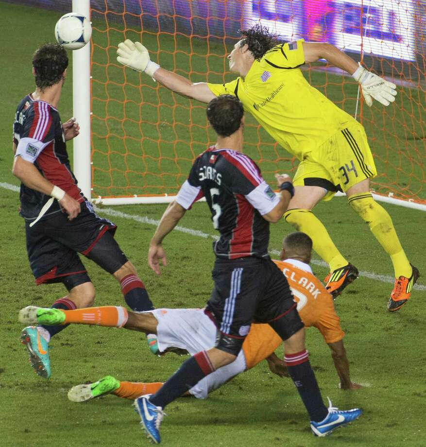 Ricardo Clark's deflection of Brad Davis' centering pass eludes Revolution keeper Bobby Shuttleworth for a goal in the 77th minute in the Dynamo's 2-0 victory. Photo: Smiley N. Pool / © 2012  Houston Chronicle