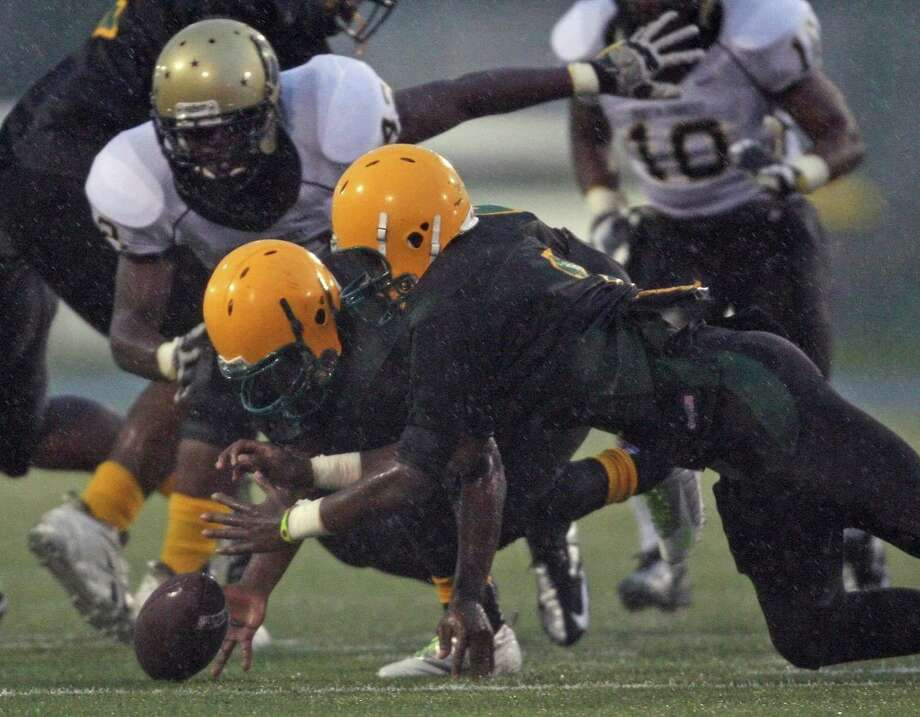 North Forest 43, Sharpstown 0Sharpstown's Jarrett Egenti  (right) and Jerrod Taylor try to recover an Apollo fumble as North Forest's Andrew Holiday closes in during the first half of a high school football game, Saturday, September 29, 2012 at Butler Stadium in Houston, TX. Photo: Eric Christian Smith, For The Chronicle