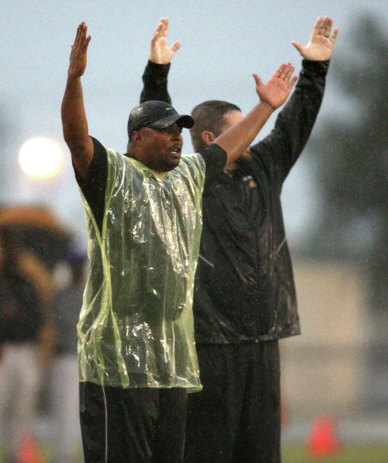 "During a discussion amongst the officials, North Forest head coach Plez Atkins (left) signals ""Touchdown"" during the first half of a high school football game against Sharpstown, Saturday, September 29, 2012 at Butler Stadium in Houston, TX. Photo: Eric Christian Smith, For The Chronicle"