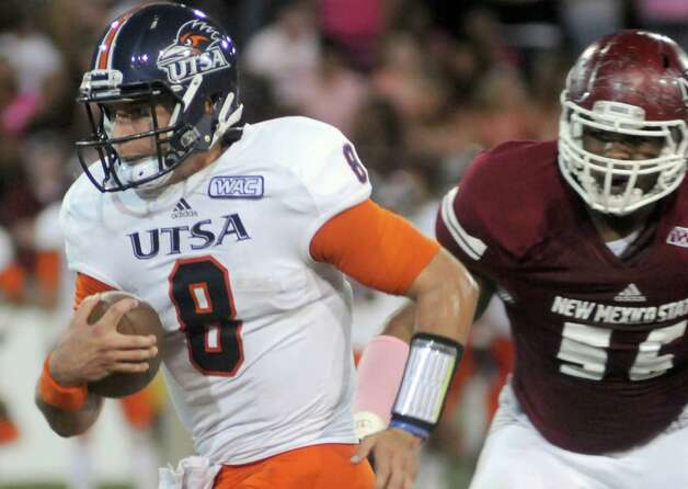 University of Texas San Antonio quarterback Eric Soza dashes past New Mexico State defensive lineman Kevin Laudermill and scores a touchdown during an NCAA college football game Saturday, Sept. 29, 2012, in Las Cruces, N.M. (AP Photo/Las Cruces Sun-News, Robin Zielinski) Photo: Robin Zielinski, Associated Press / Las Cruces Sun-News