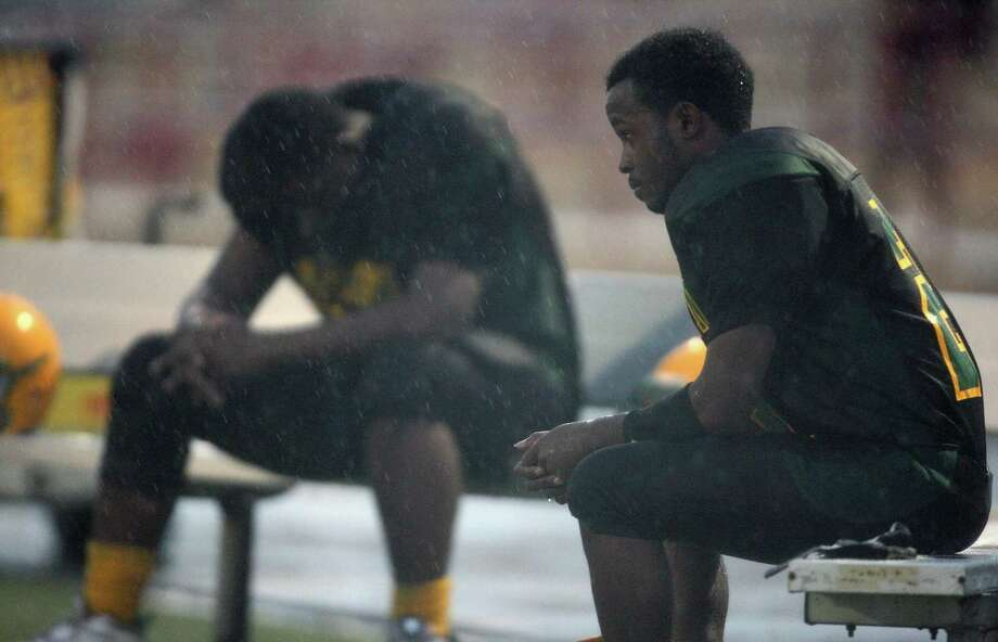 Trailing 34-0 to North Forest in the second quarter, Sharpstown's Brandon Macias (right) and Bernard Holmes find time to collect their thoughts during a high school football game, Saturday, September 29, 2012 at Butler Stadium in Houston, TX. Photo: Eric Christian Smith, For The Chronicle