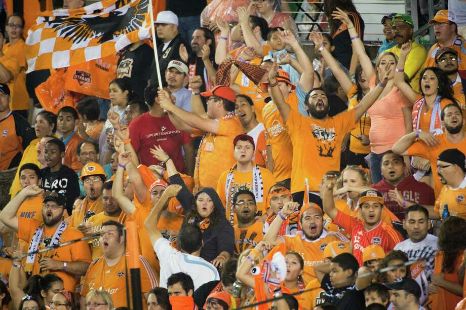 Houston Dynamo fans cheer their team during the second half against the New England Revolution on Saturday, Sept. 29, 2012, at BBVA Compass Stadium in Houston. The Dynamo won the game 2-0. Photo: Smiley N. Pool, Houston Chronicle / © 2012  Houston Chronicle