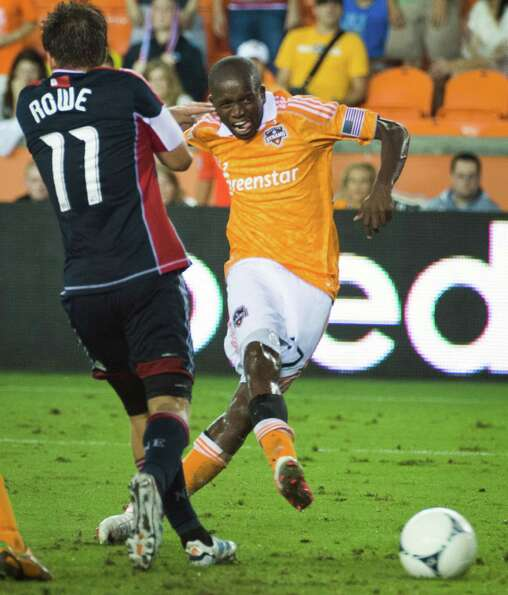 Houston Dynamo midfielder Boniek Garcia (27) makes a shot past New England Revolution midfielder Kel