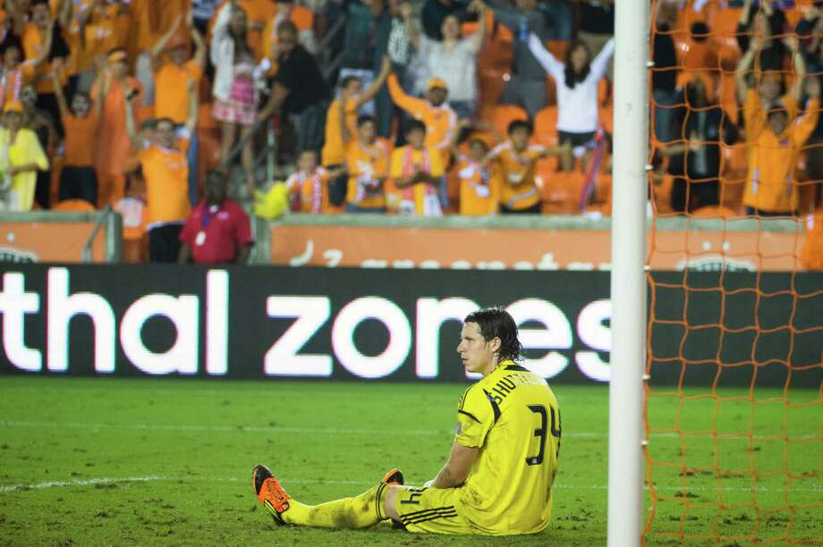 New England Revolution goalkeeper Bobby Shuttleworth (34) reacts after a goal by Houston Dynamo midfielder Boniek Garcia in the 93rd minute of an MLS soccer match on Saturday, Sept. 29, 2012, at BBVA Compass Stadium in Houston. The Dynamo won the game 2-0. Photo: Smiley N. Pool, Houston Chronicle / © 2012  Houston Chronicle