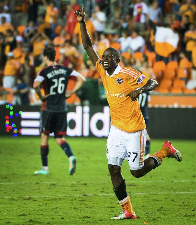 Houston Dynamo midfielder Boniek Garcia (27) celebrates after scoring a goal in the 93rd minute of an MLS soccer match against the New England Revolution on Saturday, Sept. 29, 2012, at BBVA Compass Stadium in Houston. The Dynamo won the game 2-0. Photo: Smiley N. Pool, Houston Chronicle / © 2012  Houston Chronicle