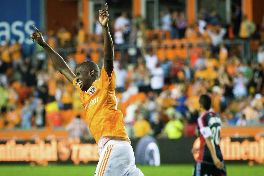 Houston Dynamo midfielder Boniek Garcia celebrates after scoring a goal in the 93rd minute of an MLS soccer match against the New England Revolution on Saturday, Sept. 29, 2012, at BBVA Compass Stadium in Houston. The Dynamo won the game 2-0. Photo: Smiley N. Pool, Houston Chronicle / © 2012  Houston Chronicle