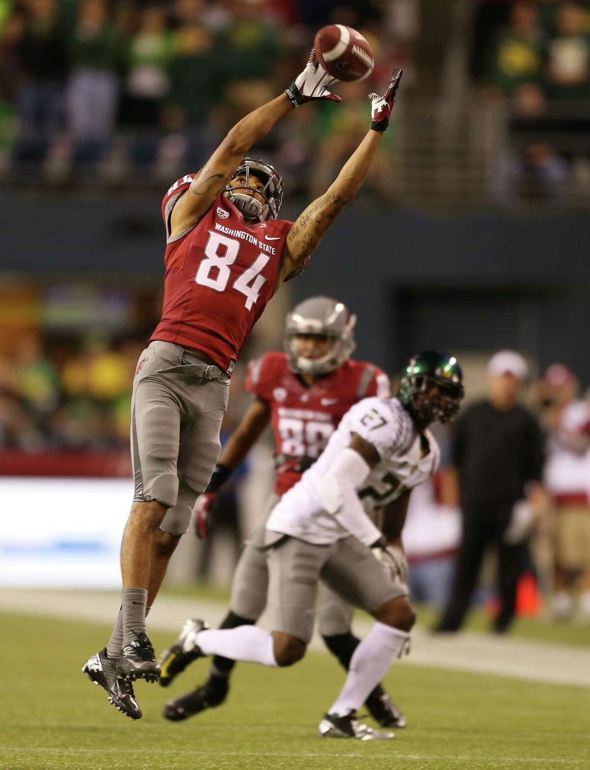 SEATTLE, WA - SEPTEMBER 29: Wide receiver Gabe Marks #84 of the Washington State Cougars makes a catch against the Oregon Ducks on September 29, 2012 at CenturyLink Field in Seattle, Washington.