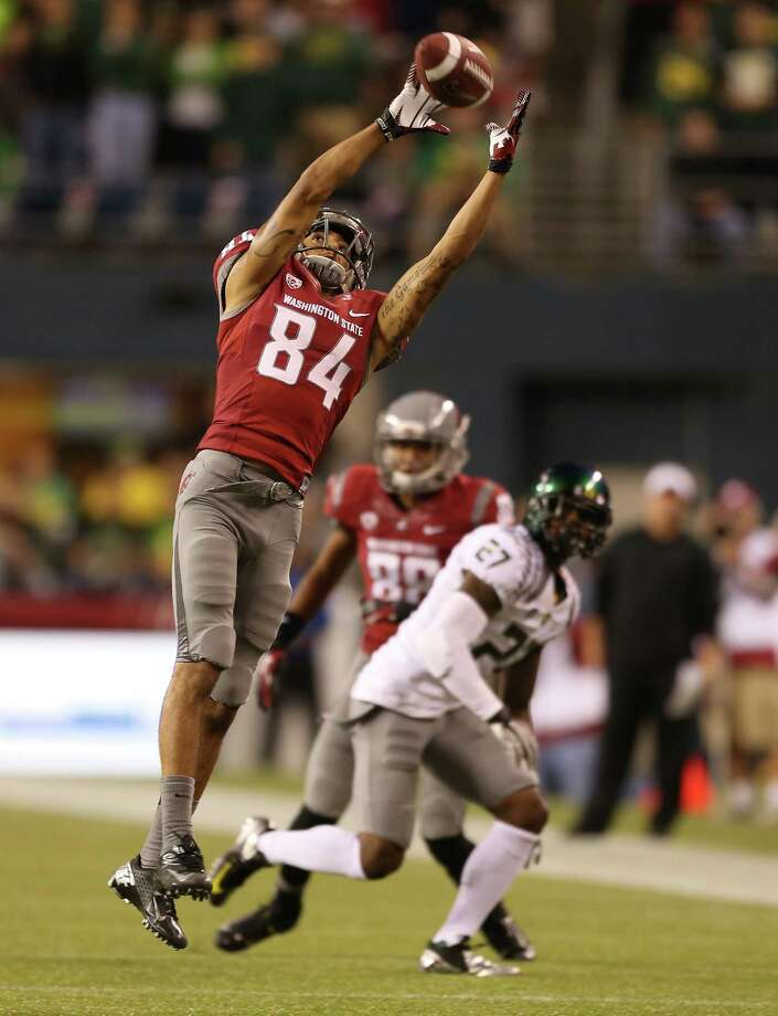 SEATTLE, WA - SEPTEMBER 29:  Wide receiver Gabe Marks #84 of the Washington State Cougars makes a catch against the Oregon Ducks on September 29, 2012 at CenturyLink Field in Seattle, Washington. Photo: Otto Greule Jr, Getty Images / 2012 Getty Images
