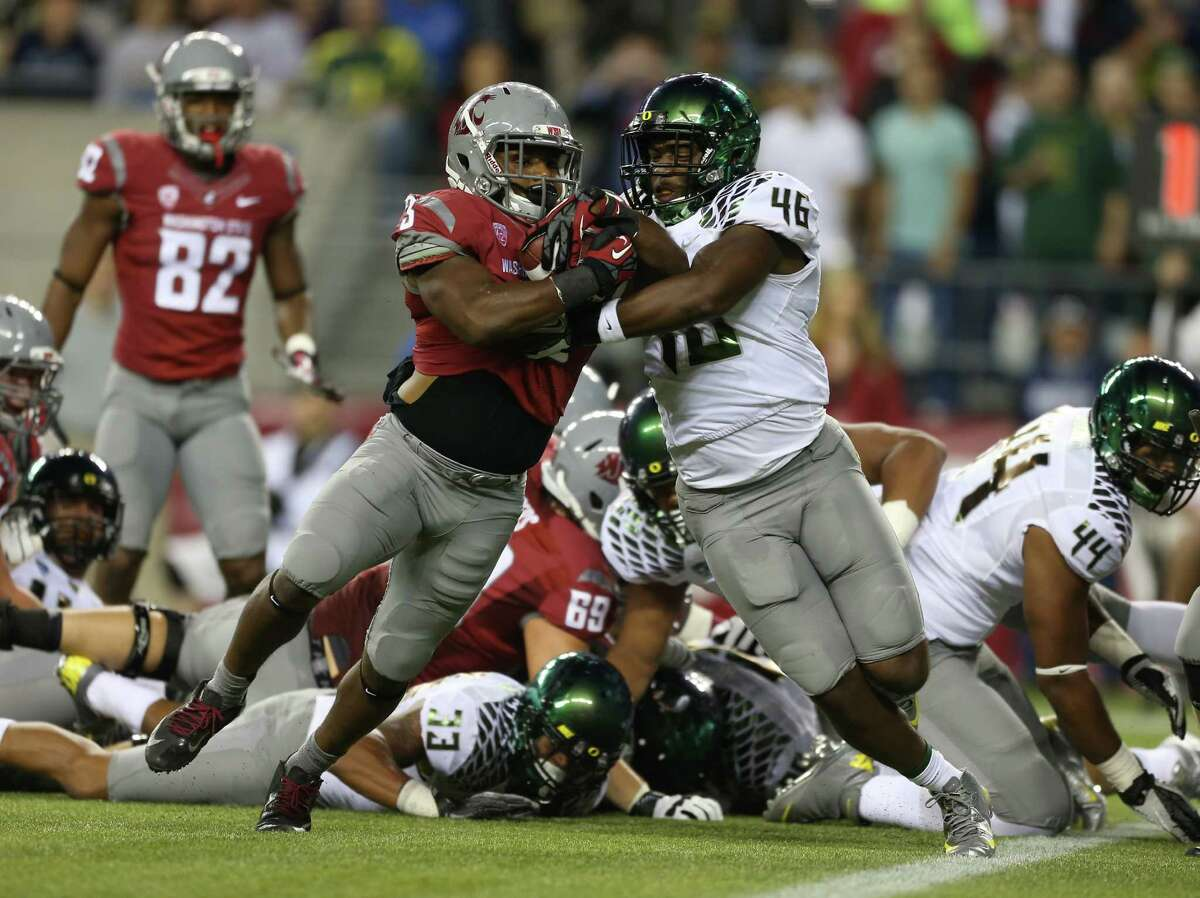 SEATTLE, WA - SEPTEMBER 29: Running back Carl Winston #3 of the Washington State Cougars rushes for a touchdown against linebacker Michael Clay #46 of the Oregon Ducks on September 29, 2012 at CenturyLink Field in Seattle, Washington.
