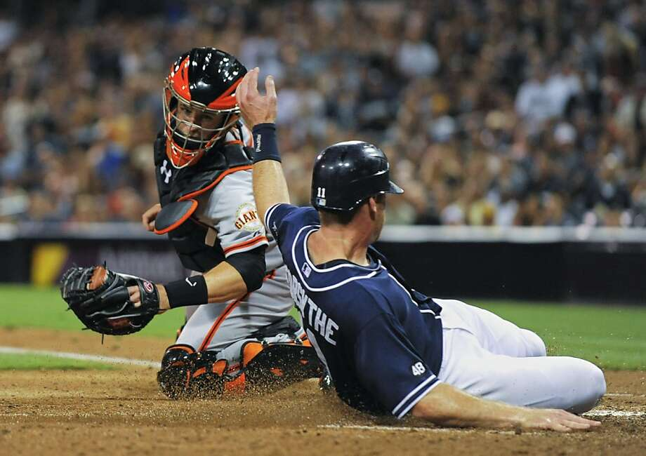 SAN DIEGO, CA - SEPTEMBER 29: Logan Forsythe #11 of the San Diego Padres scores ahead of the tag of Buster Posey #28 of the San Francisco Giants during the fifth inning of a baseball game at Petco Park on September 29, 2012 in San Diego, California. (Photo by Denis Poroy/Getty Images) Photo: Denis Poroy, Getty Images
