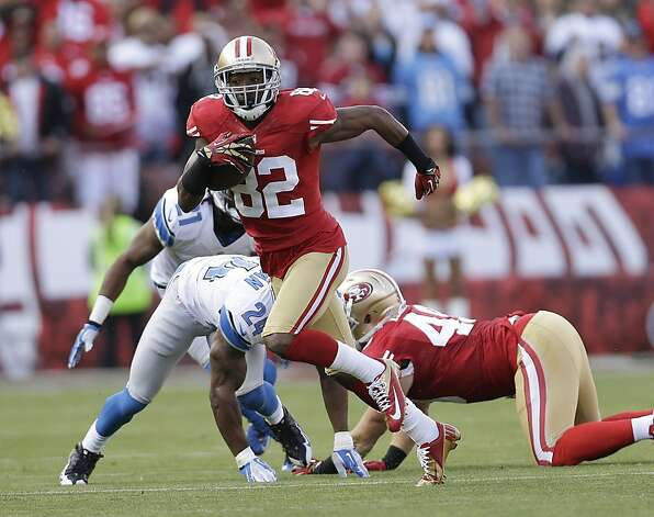 San Francisco 49ers wide receiver Mario Manningham runs with the ball past Detroit Lions strong safety Erik Coleman (24) during the first quarter of an NFL football game in San Francisco, Sunday, Sept. 16, 2012. (AP Photo/Marcio Jose Sanchez) Photo: Marcio Jose Sanchez, Associated Press