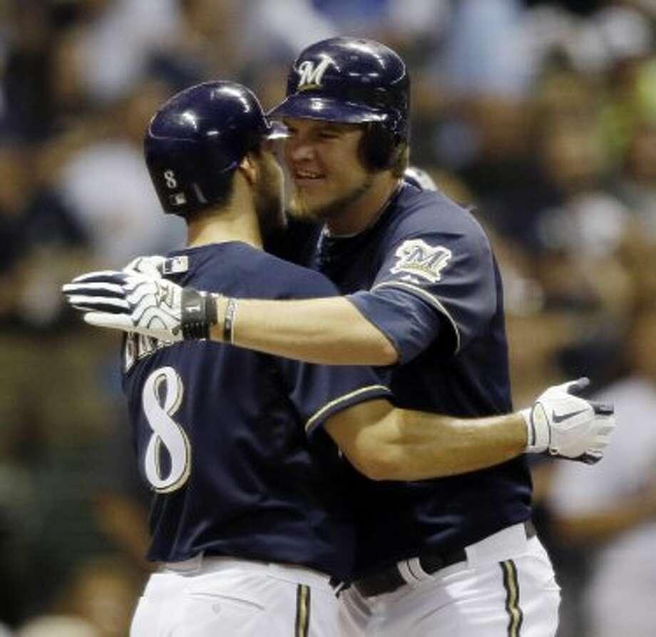 Corey Hart, right, reacts with Ryan Braun after Hart's three-run home run. (JEFFREY PHELPS / Associated Press)
