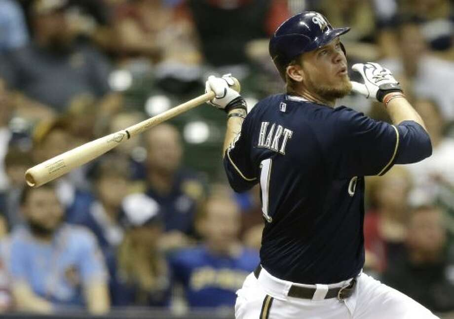 Corey Hart watches his three-run home run against the Astros. (JEFFREY PHELPS / Associated Press)