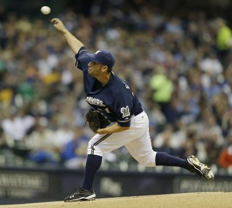 Marco Estrada throws to the Astros during the first inning. (JEFFREY PHELPS / Associated Press)