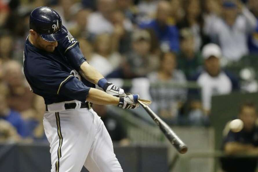 Jonathan Lucroy breaks his bat on a single. (JEFFREY PHELPS / Associated Press)