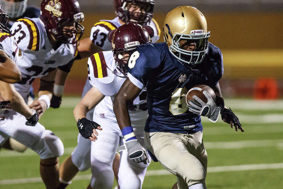 Holy Cross running back Kyron Davis (right) breaks clear for extra yardage during their game with San Antonio Christian at Harlandale Memorial Stadium on Sept. 29, 2012.  MARVIN PFEIFFER/ mpfeiffer@express-news.net Photo: MARVIN PFEIFFER, Express-News / Express-News 2012