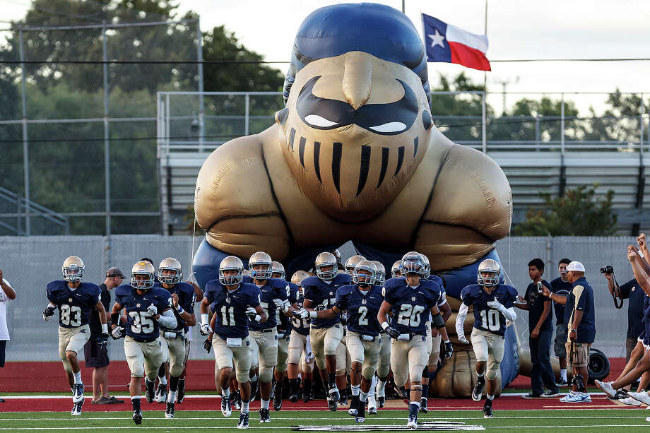 The Holy Cross Knights take the field prior to their game with San Antonio Christian at Harlandale Memorial Stadium on Sept. 29, 2012. Holy Cross won the game 25-23.  MARVIN PFEIFFER/ mpfeiffer@express-news.net Photo: MARVIN PFEIFFER, Express-News / Express-News 2012