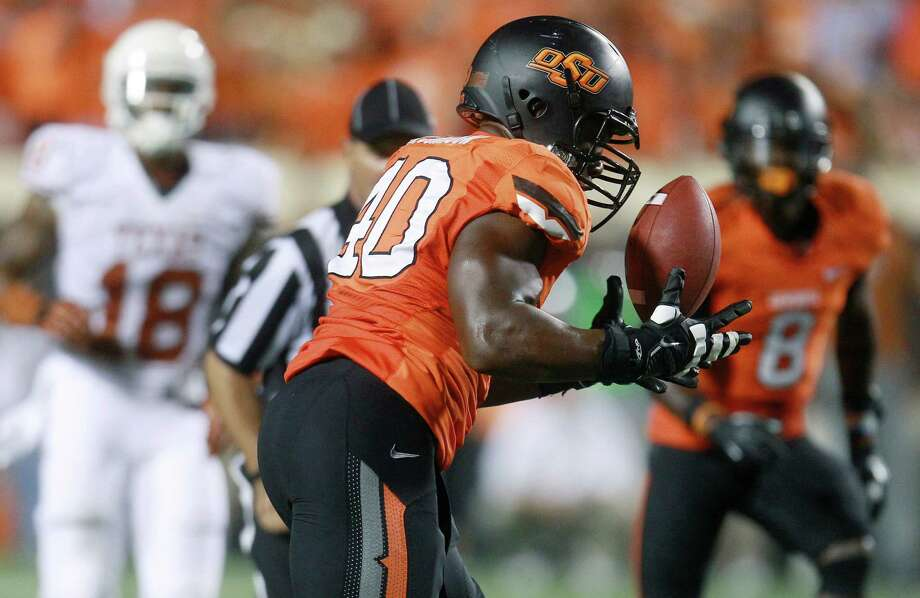 Oklahoma State defensive end Tyler Johnson intercepts a pass against Texas in the third quarter of an NCAA college football game in Stillwater, Okla., Saturday, Sept. 29, 2012. Texas won 41-36. (AP Photo/Sue Ogrocki) Photo: Sue Ogrocki, Associated Press / AP