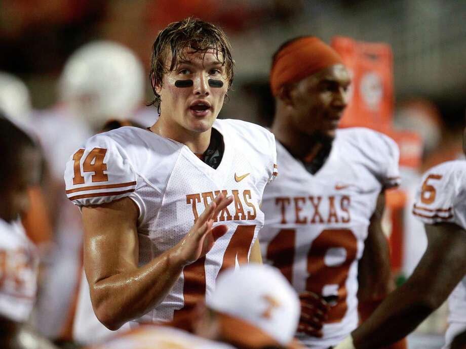 Texas quarterback David Ash (14) talks with his teammates on the bench in the fourth quarter of an NCAA college football game against Oklahoma State in Stillwater, Okla., Saturday, Sept. 29, 2012. Texas won 41-36. (AP Photo/Sue Ogrocki) Photo: Sue Ogrocki, Associated Press / AP