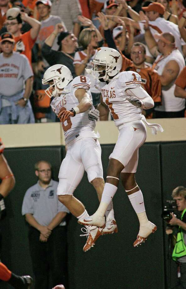 STILLWATER, OK - SEPTEMBER 29: Wide receiver Mike Davis #1 and wide receiver Jaxon Shipley #8 of the Texas Longhorns celebrate a touchdown against the Oklahoma State Cowboys September 29, 2012 at Boone Pickens Stadium in Stillwater, Oklahoma. Photo: Brett Deering, Getty Images / 2012 Getty Images