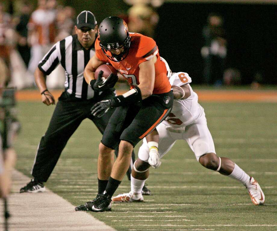 STILLWATER, OK - SEPTEMBER 29: Wide receiver David Glidden #6 of the Oklahoma State Cowboys tries to stay in bounds under pressure from cornerback Quandre Diggs #6 of the Texas Longhorns on September 29, 2012 at Boone Pickens Stadium in Stillwater, Oklahoma. Photo: Brett Deering, Getty Images / 2012 Getty Images