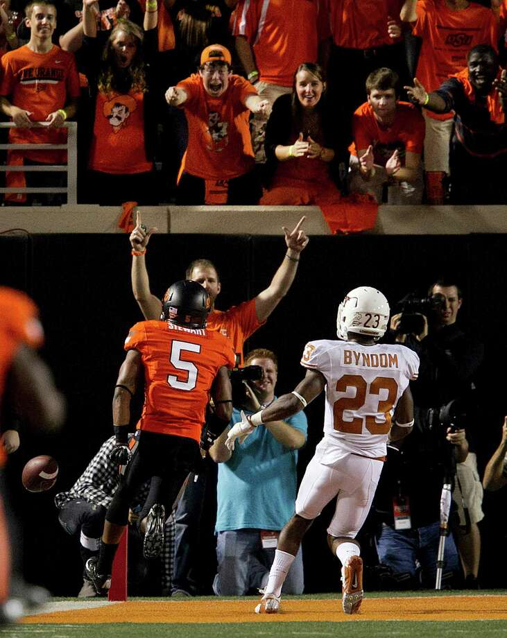 Texas' Carrington Byndom lags behind as Oklahoma State's Josh Stewart scores during the first quarter in Stillwater, Oklahoma, on Saturday, September 29, 2012. (Deborah Cannon/Austin American-Statesman/MCT) Photo: Deborah Cannon, McClatchy-Tribune News Service / Austin American-Statesman